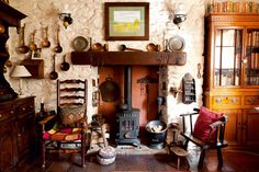 Found on Period Living. I LOVE this! I personally wouldn't have the brass or too many cabinets... but id definitely have a welsh dresser, the wood burner and that floating fire surround is A MUST!! <3. This is a proper traditional welsh cottage :)