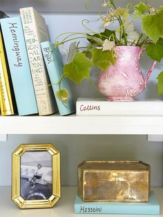 There's no storage rule that says every square inch of a shelf must be crammed full of stuff. In fact, that's a quick way to lose track of items and to create unwanted visual clutter. Instead, try alternating vertical and horizontal elements. If one section of a shelf has several books or containers, give the other side some visual breathing space with a photo or other collectible.