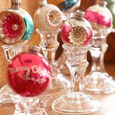Vintage Christmas Ornaments.... I love to put my special ornaments on  silver, brass or glass candlestick holders