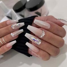 When creating a look for your nails that is interesting yet classy, consider white nail designs. The bright, crisp coloring makes your nails stand out, while its neutral nature keeps it from ever looking gauche. White Coffin Nails, Bling Acrylic Nails, Best Acrylic Nails, Rhinestone Nails, Acrylic Nail Designs, Pink Nails, White Nail, Pink White, Wedding Gel Nails