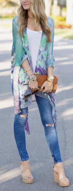 Spring outfit featuring white top, skinny jeans, nude platform shoes, boho scarf, brown clutch bag Image source