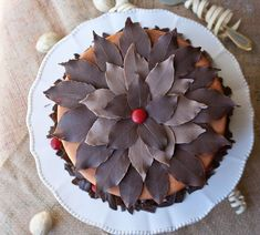 Use this cake decorating tutorial to learn how to make chocolate leaves with melted chocolate and edible mint leaves. Easy way to decorate Fall cakes. Chocolate Tree, Chocolate Flowers, How To Make Chocolate, Homemade Chocolate, Melting Chocolate, Chocolate Recipes, Diy Thanksgiving Crafts, Fall Cakes, Chocolate Decorations
