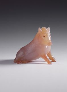 Faberge Wild Boar,   Creator:  Fabergé (jeweller) Creation Date:  c. 1908 Materials:  Chalcedony, cabochon rubies Dimensions:  6.7 x 8.6 x 5.0 cm   Acquirer:  King George V, King of the United Kingdom (1865-1936) Provenance:  Bought by King George V, when Prince of Wales, from Fabergé's London branch, December 1909 (£31)