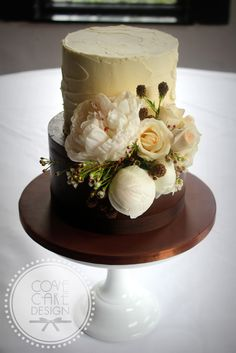 Naked chocolate ganache and rustic buttercream wedding cake with fresh peonies and roses