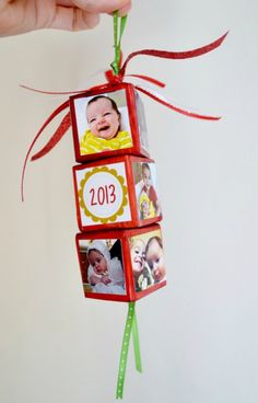 handmade Christmas ornament ... three small baby blocks the the year and adorable photos   ...  strung together with narrow ribbon ... great family gift ... could start a tradition ...