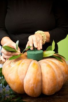 DIY Thanksgiving Pumpkin & Floral Centerpiece & Tablescape from Holly Heider Chapple Thanksgiving Centerpieces, Diy Thanksgiving, Fall Table Centerpieces, Harvest Table Decorations, White Pumpkin Centerpieces, Pumpkin Vase, Large Pumpkin, Fall Arrangements, Pumpkin Floral Arrangements