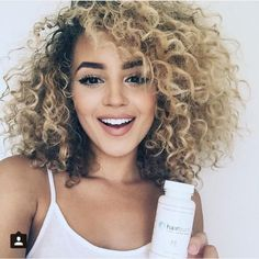 Curly Hair Styles -                                                              I'm really into blond dyed curls with roots. This layered cut with bangs is hot..