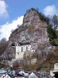 The Felsenkirche, a church built into a natural niche in the rocks, rises high above the houses of Idar-Oberstein, Germany. Where else is there a church that can only be entered through a tunnel which was dug into the rocks (1980-1981)?