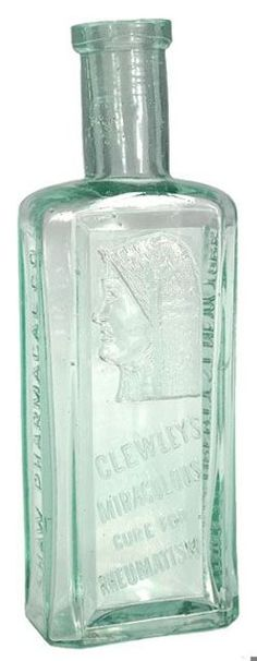 Clewley's Miraculous Cure for Rheum, Shaw Pharmacal Co, New York, Aqua, 6 inch A Clewley's Miraculous Cure for Rheum glass medicine bottle with embossed image of a woman wearing a hood