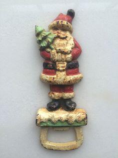 SOLD! Primitive Folk Art Cast Iron Red Santa with Brush Tree Pop Beer Bottle Opener