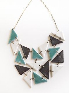 Handmade porcelain jewelry triangle statement bib necklace in turqoise grey and white glazes. $125.00, via Etsy.