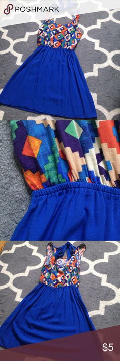 Edge Dress This is a very light weight dress by Edge. It has a cute pattern on the top of orange, blue, purple, green, tan, and cream. It has a elastic in the middle to make the fitting tighter in the midsection. It ties in the back on the top and is in great shape! Dresses