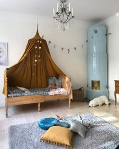 Vintage kids bed with antique gold canopy