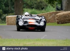 Download this stock image: Justin Maeers aboard a 1959 Cooper Monaco at The Chateau Impney Hillclimb 2016 - h9ggbn from Alamy's library of millions of high resolution stock photos, illustrations and vectors.