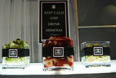 Garnishes for the drinks were displayed in square glass containers decorated in black ribbon and finished off with Chanel logo.