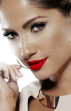 Jennifer Lopez wears Traffic Red lips, with neutral shimmery dark ivory skin tone.