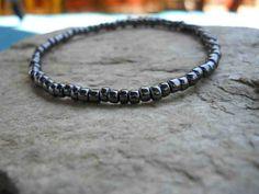 Pretty handmade black Japanese glass bead stretchy bangle by FeekoByDesign on Etsy, $3.00