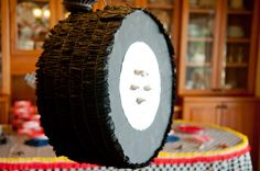 NASCAR Birthday party with tire pinata made from sewn crepe paper and Hershey kisses