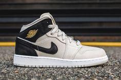 http://SneakersCartel.com Air Jordan 1 Mid in Light Bone and Metallic Gold #sneakers #shoes #kicks #jordan #lebron #nba #nike #adidas #reebok #airjordan #sneakerhead #fashion #sneakerscartel