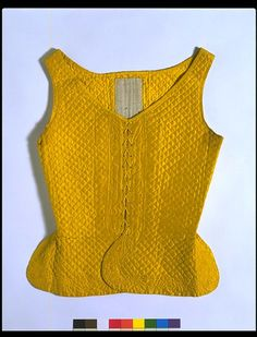 c1745 Women's waistcoats were usually sleeveless like a man's waistcoat, but shorter and shaped to fit over stays. Worn with a petticoat and bedgown, a waistcoat formed part of the informal ensemble of women's dress. It could be worn under a gown to provide extra warmth. This waistcoat is made of silk quilted in a diaper pattern. Bright yellow was a popular colour for women's dress from the 1740s to the 1770s. Quilting was a common type of needlework in the 18th century, as it was both…