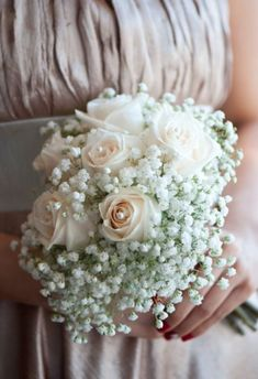 Bridesmaids Bouquet Ideas - plain baby's breath for bridesmaids, but a different bouqet for MOH