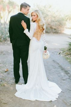 There is no doubt that this is a bridal look that will turn a few heads. Bride Nicole wore this knockout gown from Inbal Dror. See more of her sophisticated bridal style with photos by Wai Reyes Photography | via junebugweddings.com