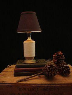 Upcycled Vintage Textile Mill Thread Spool Lamp. $72.00, via Etsy.