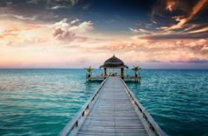 Romantic memories are made in The Maldives. Discover a world where beachfront luxury and champagne sunsets are at your fingertips. #luxury #travel