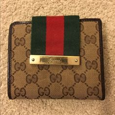 Offers accepted!  Authentic Gucci wallet Authentic Gucci wallet. Normal wear. Edges and corners in great shape. Excellent condition. 12 card slots and pocket for cash. Zipper compartment on back. Perfect slim wallet for smaller bags. Wallet measures 5 in X 4 in. Gucci Bags Wallets