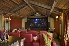 Stunning rustic home theater by Locati Architects with red theater chairs and ex. - Home Theater Systems - At Home Movie Theater, Home Theater Rooms, Home Theater Seating, Home Theater Design, Home Interior Design, Theater Seats, Attic Design, Cinema Room, Room Interior