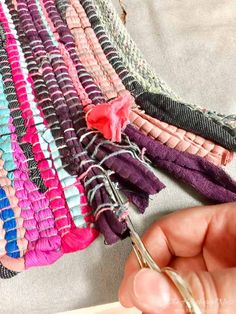 creating fringe from a rag rug to make a DIY clutch