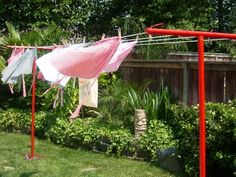 Remember the days when EVERY backyard had a clothesline! :) and this red is fantastic!I use mine for the fresh air scent! Outdoor Clothes Lines, Outdoor Outfit, Outdoor Decor, Outdoor Living, Outdoor Ideas, Tube Carton, Vintage Housewife, Backyard Fences, Backyard Projects