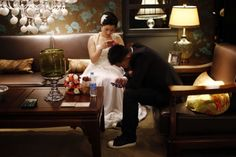 A couple waits to participate in a staged mass wedding in Shanghai