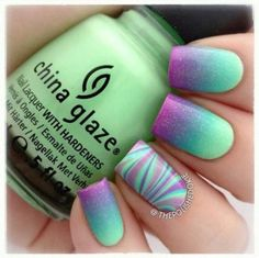 Sea foam green to purple ombré nails with psychedelic accent nail.