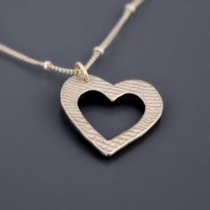 Sterling Silver Textured Heart Necklace by Lisa Hopkins Design.... i really want this