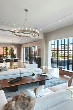 Modern Vs. Contemporary This Contemporary All White Living Room Showcases A  Custom Cascading Light Fixture And Sweeping Glass Windows With Sheer Teu2026 Part 87