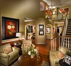 Open archways, crown molding, natural wood, green and bronze wall paint.