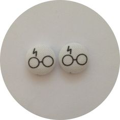 """super adorable harry potter inspired print measuring 1/2"""" on stainless steel post.  Perfect for harry potter fan!  This print is only found here at Little Big Fabric,you will be wearing something very special and created by LBF  As all of my earrings are handmade and due to the fabric patte..."""