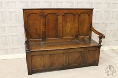 A classic piece of early English furniture: this George III solid oak box settle.  #settle #bench #antique #storage