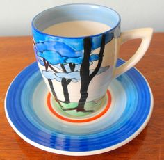 CLARICE CLIFF - BLUE FIRS CUP & SAUCER - UNUSUAL LYNTON SHAPE