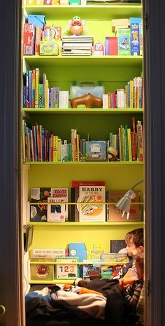 Closet turned into reading nook, this would be cute in a living room area of a home.