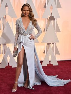 It may be John Legend's big night, but that didn't stop his wife Chrissy Teigen from stealing the show! The Sports Illustrated model turned heads on the red carpet when she donned a revealing Zuhair Murad gown on Feb. 22, 2015.
