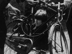 """GEORGE HARRISON """"WORKING ON A BIKE"""" 1964"""
