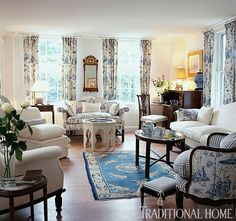 Blue and white prevail in this living room, enhanced only by subtle touches of yellow. - Traditional Home ® / Photo: Eric Roth / Design: Ginger Aborn