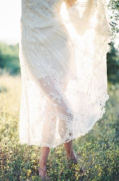 Meadow and a delicate white dress in the summer sun