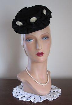 1940's Perky Black Wool Tilt Topper Hat with Ruffled Brim and Velvet Buttons.