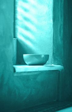 Turquoise wall and window seat