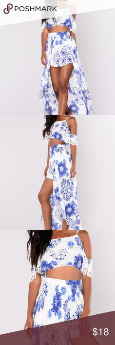 """White/Blue Cotton Boho Matching Set- Worn Once Incredibly cute white & blue cotton matching set. Off the shoulder crop top with maxi skirt including peek-a-boo shorts. Worn once for my bachelorette party. Medium, fits very well. I'm 5'9"""" and it looked great- could be paired with heels if shorter. Fashion Nova Dresses Maxi"""