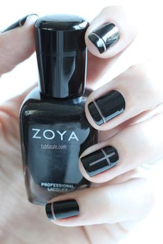 negative space cross manicure - nail art using black nail polish and striping tape