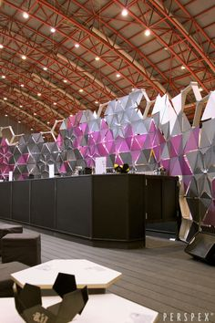 Another photo of the Perspex® /Lucite Lux® bar centerpiece at the 100% Design show. (Credit: Viable London)